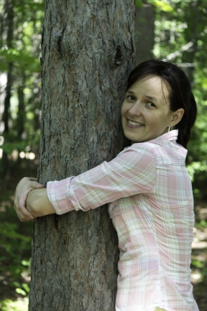 Young woman hugging a tree photo