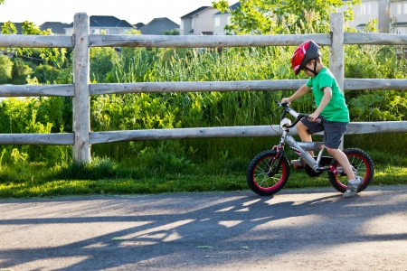 Child bicycling on the bike path in the park