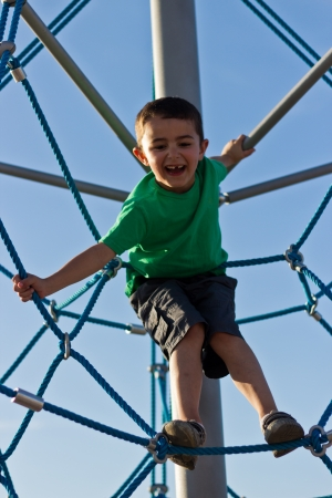 Child playing on the play structure in the park photo