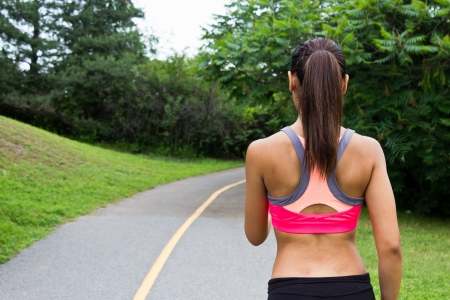 bra: Young woman running on the jogging trail