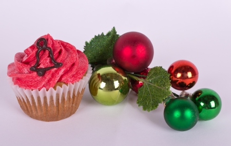 Christmas tree ornament and cupcake with bell