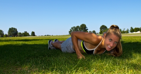 push: Fit, athletic woman doing push ups