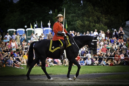 mountie: OTTAWA, CANADA - JUNE 27, 2013  Superintendent Marty Chesser of the Royal Canadian Mounted Police  RCMP  leads the Musical Ride to its Sunset Ceremony performance on June 27, 2013