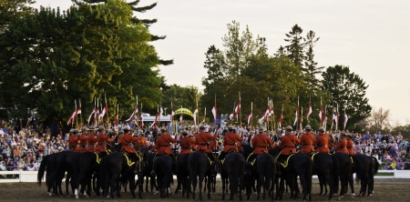 mountie: OTTAWA, CANADA - JUNE 27, 2013  The Royal Canadian Mounted Police  RCMP  Musical Ride performs during its Sunset Ceremonies series in Ottawa, Canada on June 27, 2013
