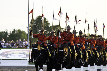 OTTAWA, CANADA - JUNE 27, 2013  The Royal Canadian Mounted Police  RCMP  Musical Ride performs during its Sunset Ceremonies series in Ottawa, Canada on June 27, 2013