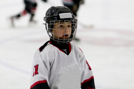 Kid playing ice hockey