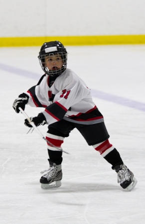 Child playing ice hockey Stock Photo
