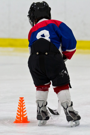 ice arena: Young hockey player at practice Stock Photo