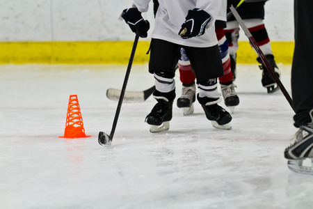 Youth ice hockey team at practice Stock Photo