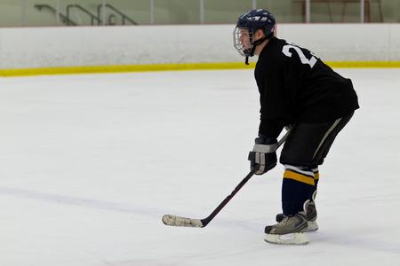 patrolling: Hockey player patrolling the blue line Stock Photo