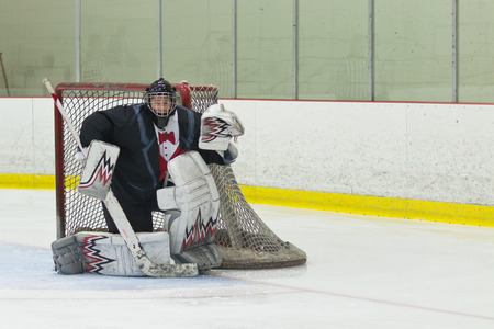 Hockey goalie ready for the puck photo