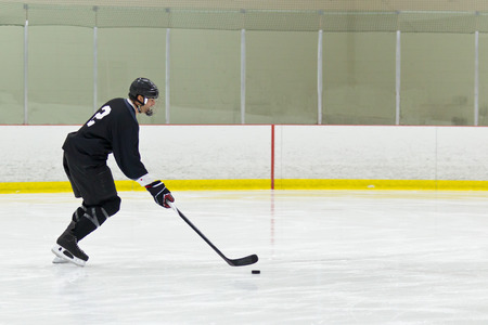 Hockey player on a breakaway shot photo