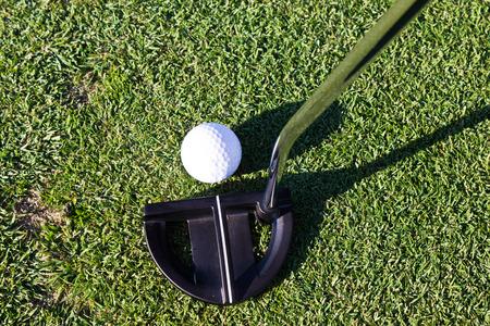 Golf ball and putter club Stok Fotoğraf