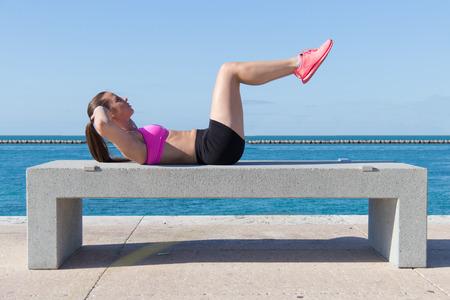 Hispanic girl doing ab crunches for fitness Stock Photo - 28668545