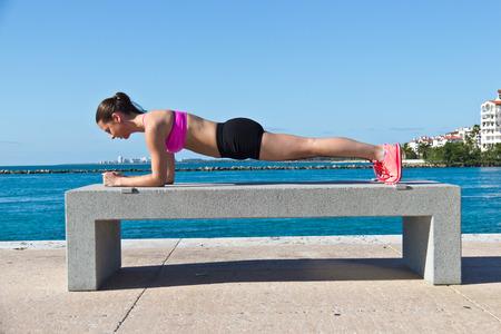Hispanic woman doing a pilates plank for fitness photo