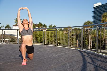 Hispanic woman doing yoga outdoors photo