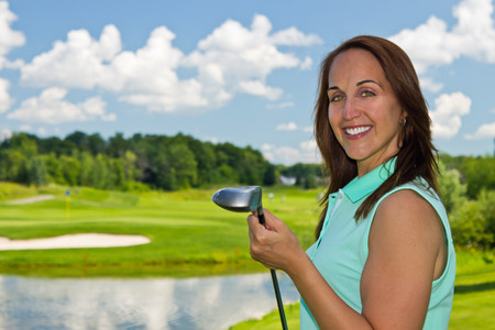 Woman at the golf course on a beautiful summer day photo