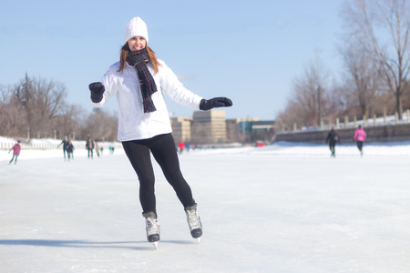 ice skating: Healthy young woman ice skating during winter