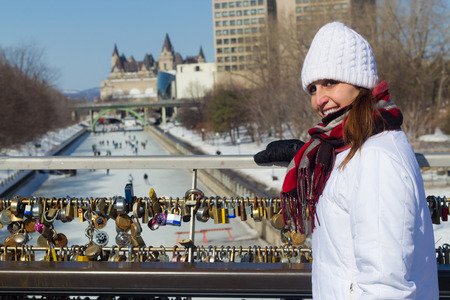 rideau canal: Winter portrait of a woman at the Ottawa Rideau Canal with love locks