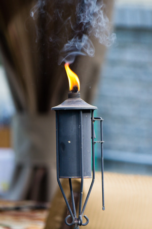 Insect repellant torch in the backyard Stock Photo