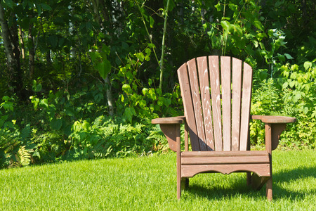 garden furniture: Adirondack summer lawn chair outside Stock Photo