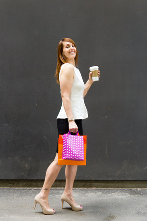 Woman with shopping bags and coffee