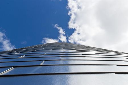 Tall building against the blue sky