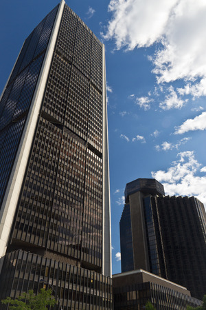 Tall downtown business buildings on a clear summer day
