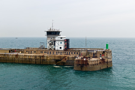 Man-made breakwater structure at port entrance