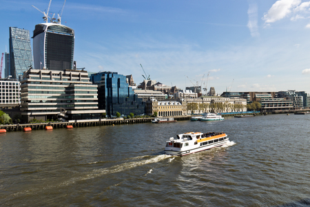 river thames: A water taxi transports people along the River Thames in London, England