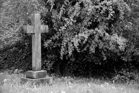 headstone: Single cross headstone in graveyard Stock Photo