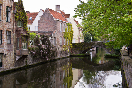 Canal with bridge in the European city of Bruges