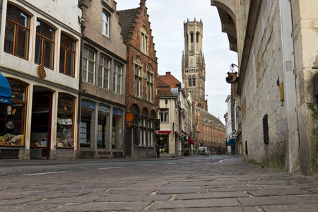 belfort: The Belfort (Belfry) seen from the quiet street in Bruges Stock Photo