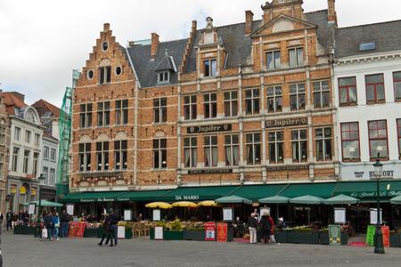 bruges: Tourists at restaurants in the market square in Bruges, Belgium Editorial