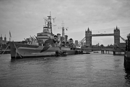 cruiser: HMS Belfast a Royal Navy light cruiser on the River Thames in London, England
