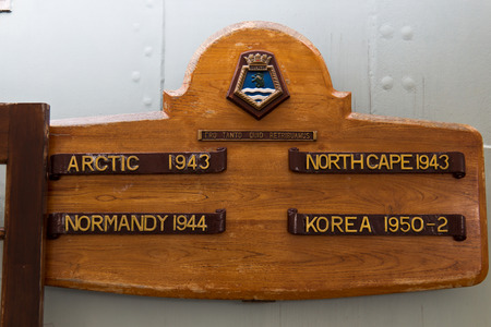 plaque: Plaque for the HMS Belfast Royal Navy light cruiser highlighting its service in WWII and the Korean Way