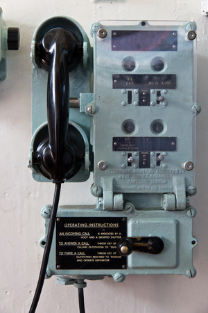 interphone: Retro telephone communication device  with buttons and dials