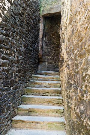 doorway: Stairs towards medieval castle tower doorway Editorial