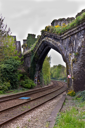 railway: Railway tracks passing through medieval stone wall