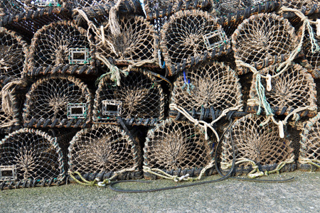 lobster pot: Group of old wooden lobster creels stacked on wharf Stock Photo