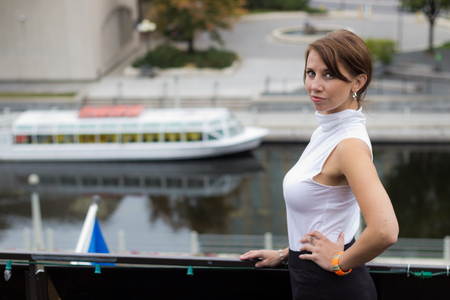sex appeal: Sexy, sofisticated woman poses by the water canal in the city
