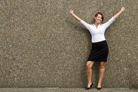 buisness: Happy buisness woman with arms up in celebration