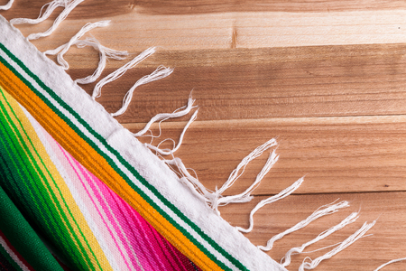 Traditional colorful Mexican serape on a table