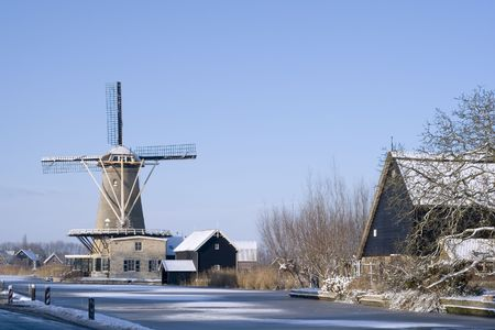 Dutch town and windmill in Southern Holland during winter Stock Photo - 6122120