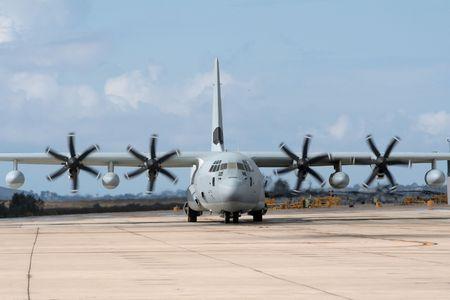 Military C-130 Hercules transport plane photo