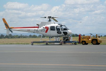 MELBOURNE; AUSTRALIA - DECEMBER 6: Channel 7 news helicopter on the apron of Melbourne Airport. December 6; 2005 in Melbourne; Australia.