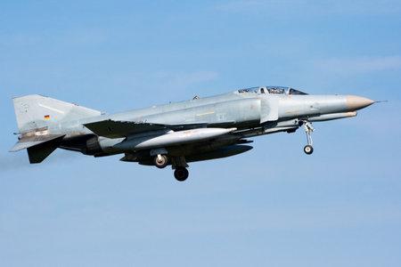 jetplane: LEEUWARDEN, THE NETHERLANDS - APRIL 12: German Air Force F-4 Phantom landing during the exercise Frisian Flag 2010. Leeuwarden Airbase april 12, 2010 in Leeuwarden, The Netherlands Editoriali
