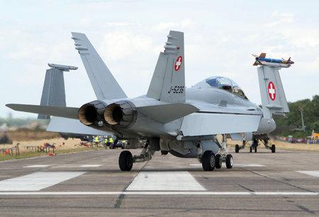 f18: KLEINE BROGEL, BELGIUM - JULY 20: Swiss Air Force F-18 Hornet taxiing after landing. Belgium Spotterday July 20, 2005 in Kleine Brogel, Belgium