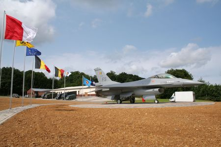 piloting: FLORENNES, BELGIUM - JULY 6: Belgian Air Force Lockheed F-16 on display at the entrance of the airbase. Belgian Defence Days. July 6, 2008 in Florennes, Belgium Editorial