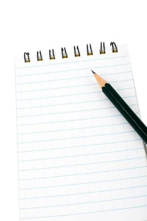Blocknote and pencil on white Standard-Bild